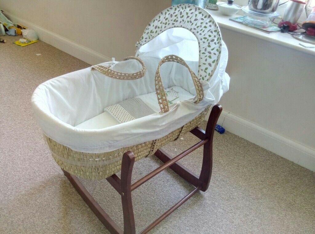 Moses basket along with rocking stand – very good condition