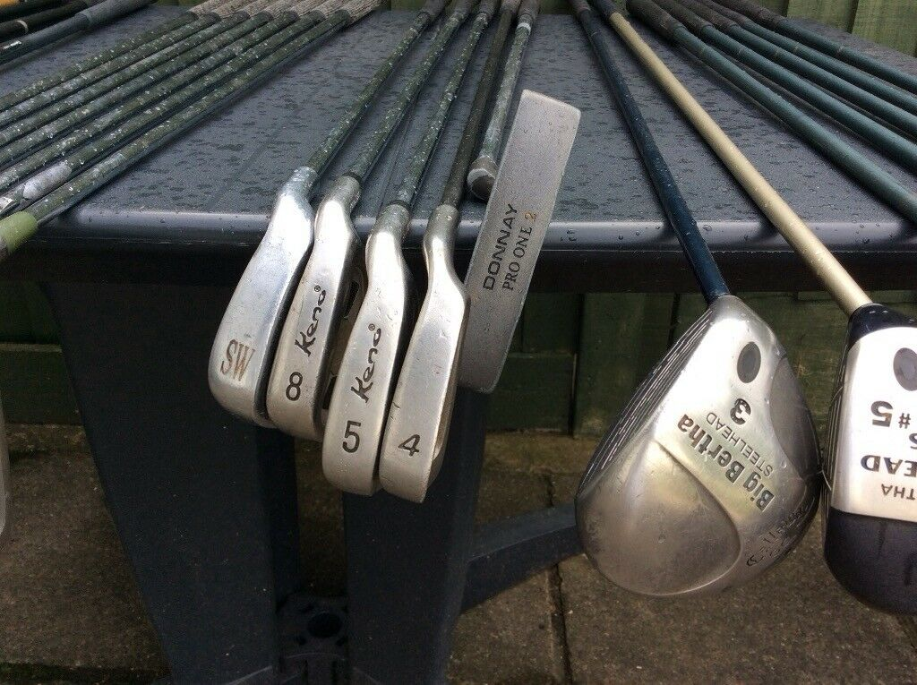 2 SETS GOLF CLUBS.33 ALTOGETHER.LADIES CALLAWAY AND WOODS. MENS IRONS AND WOODS. PUTTERS INCLUDED