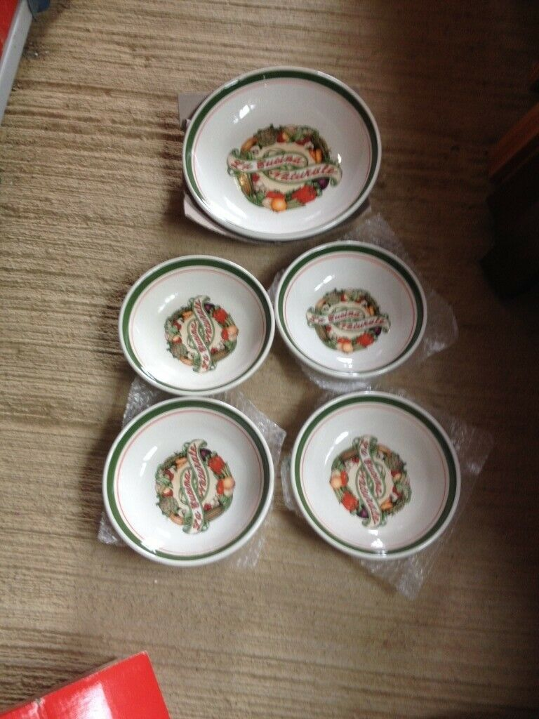 Unused, boxed pasta bowls and dish